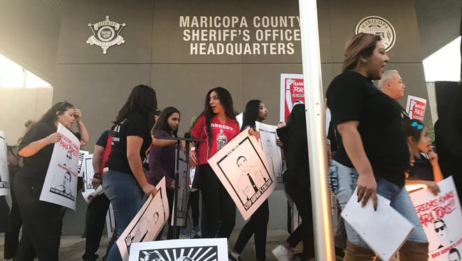 Puente Arizona and supporters protest in front of the Maricopa County Sheriff's Office headquarters in Phoenix on Dec. 11, 2017.