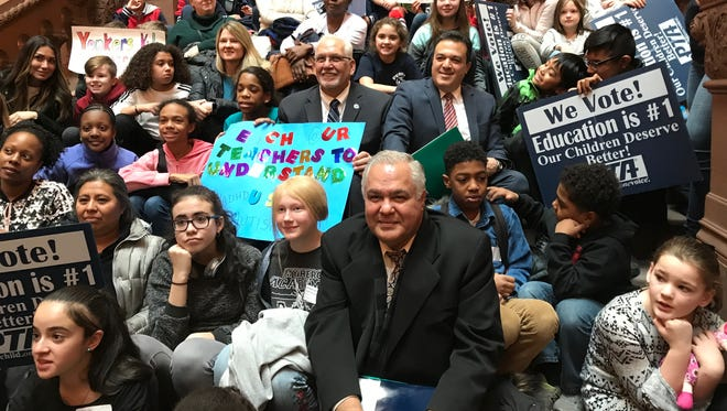 Students, parents, schools officials and state lawmakers gathered at the Million Dollar Staircase at the state Capitol on Monday, Jan. 12, 2018, to seek more state aid for the districti