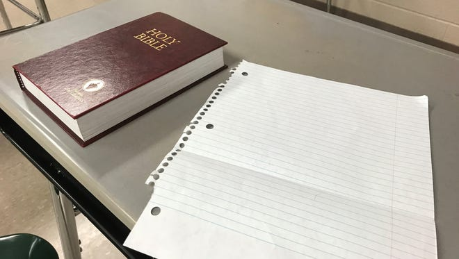 A Gideon Bible sits on a desk in Scott Kee's classroom at Liberty Tech High at the end of Bible class on Thursday.