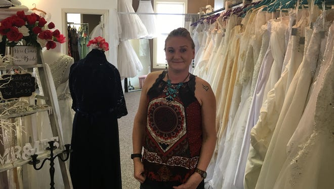 Bobbi Schroeder-Oudenhoven opened Wedding Day Dress for Less on South Broadway, above Jake's Pizza, to help brides find an affordable wedding dress.