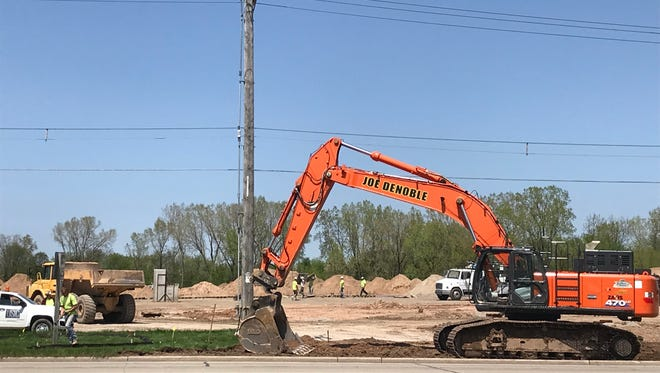 Digging and site work at Wisconsin Avenue and Interstate 41 site in Grand Chute.