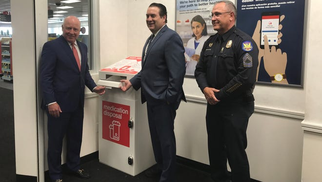(From left) Thomas Moriarty of CVS Health, Arizona Attorney General Mark Brnovich and Sgt. Tommy Thompson of the Phoenix Police Department helped launch the CVS Health drug-disposal program in Arizona.
