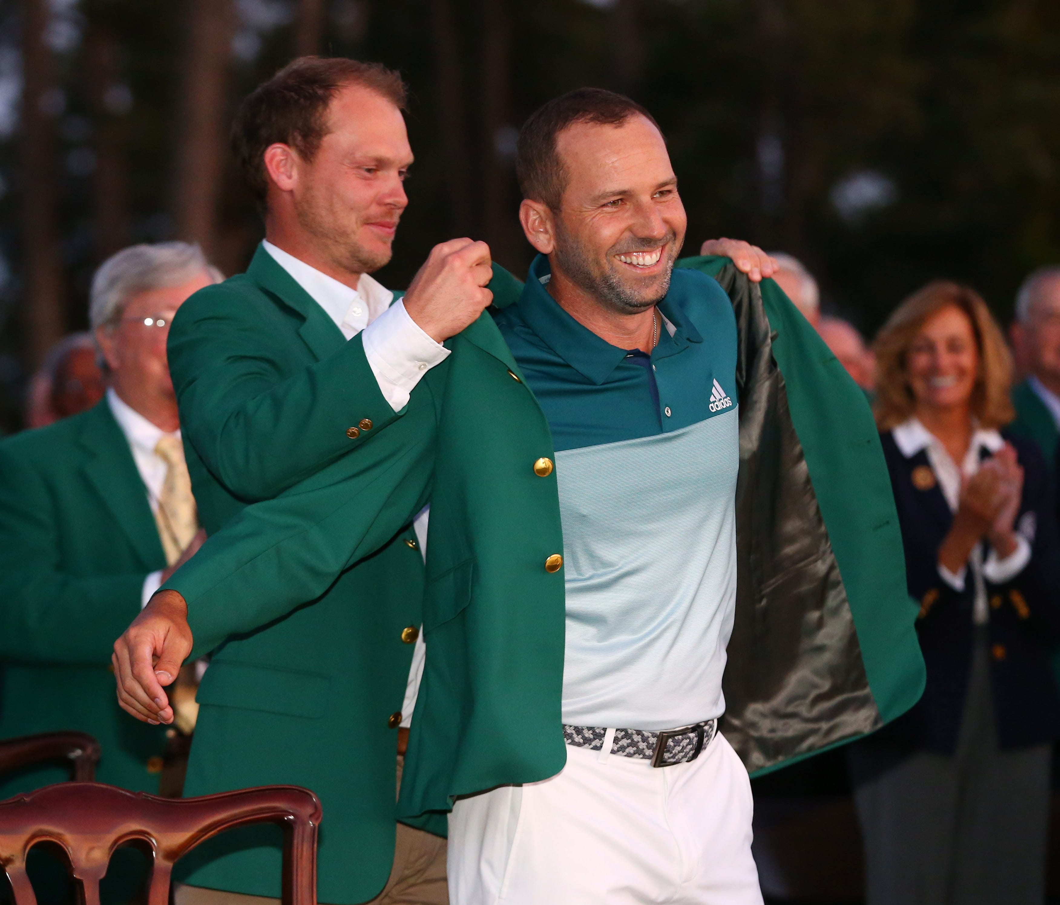 Danny Willett places the green jacket on 2017 winner Sergio Garcia after the final round of The Masters  on April 9.