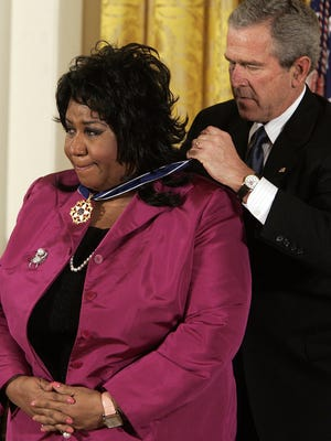 President George W. Bush presents singer Aretha  Franklin the Presidential Medal of Freedom during a ceremony in the East Room of the White House in Washington in Nov. 2005.