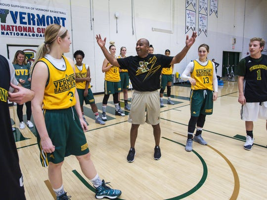Chris Day, first-year coach of the University of Vermont's women's basketball team, leads his players through practice in Burlington on Wednesday.