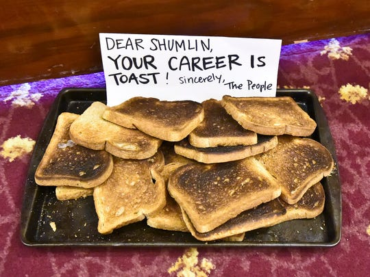 After a Thursday rally in Montpelier, people who support single-payer health care marched to Gov. Peter Shumlin's ceremonial office to deliver a tray of burnt toast and a note.