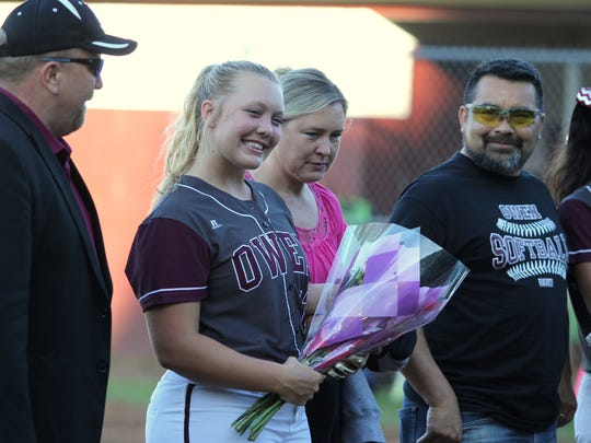 Natalie Stewart smiles big as Warlassies seniors are introduced before the game against Mountain Heritage on Senior Night. Stewart hit a solo home run in the bottom of the third inning of a 15-0 victory.