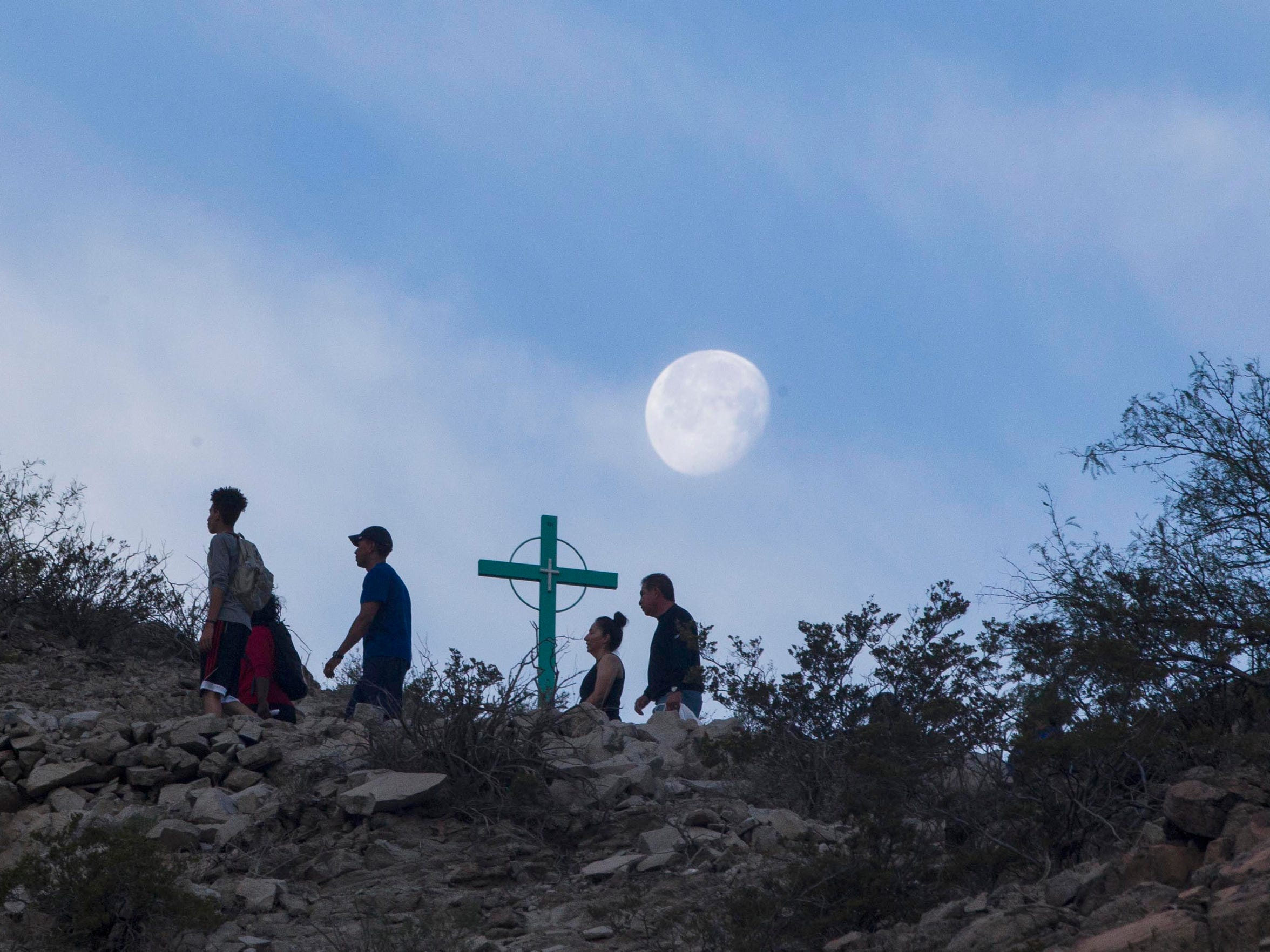 Catholic pilgrims join with others who hike  Mount