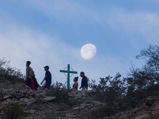 Catholic pilgrims join with others who hike  Mount Cristo Rey to pray and celebrate their faith on Good Friday in April 2017.