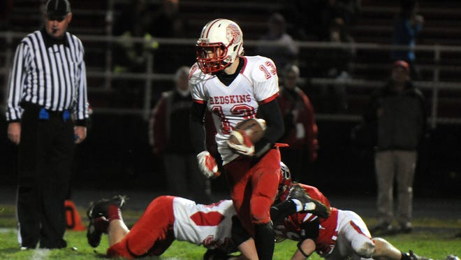 Port Clinton's Nathan Stubblefield (13) carries the ball during the Redskins' playoff game at Kenton last season. Stubblefield, a junior, started track with football in mind.