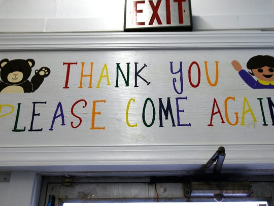 A sign above the door at Toymasters in Red Bank is