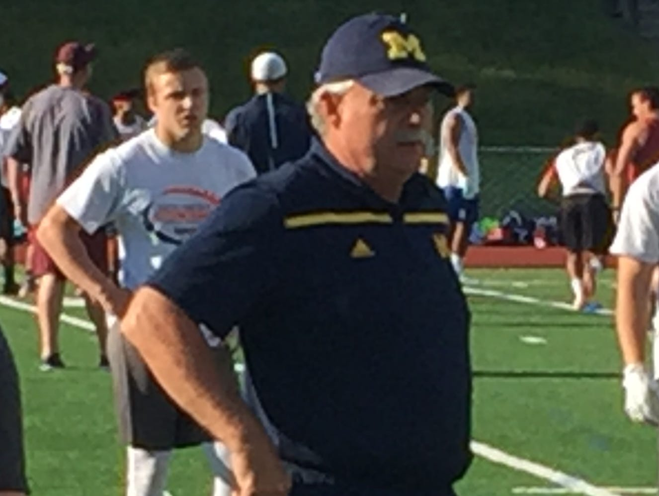 Michigan defensive coordinator Don Brown works at the Princeton, N.J., satellite camp June 7.