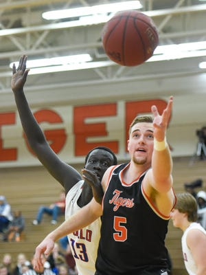 St. Cloud Tech's Kail Lindgren, 5, and St. Cloud Apollo's Deng Diew go after a rebound during the second half Tuesday, Jan. 30, at Technical High School.