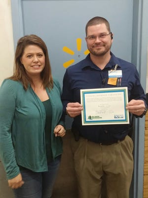 Kathryn Norbeck-Dayley, ReStore Manager and Daniel Powell, Co. Manager Walmart Store #0673