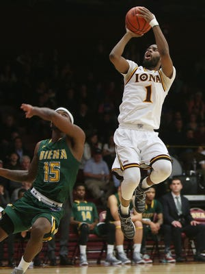 Iona's Sam Cassel Jr. (1) goes up for a shot in front of Siena's Nico Clareth (15) during college basketball action at Iona College in New Rochelle Feb. 7, 2017.