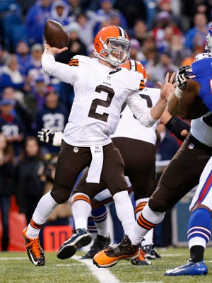 Nov 30, 2014; Orchard Park, NY, USA; Cleveland Browns quarterback Johnny Manziel (2) throws the ball against the Buffalo Bills during the second half at Ralph Wilson Stadium. The Bills won 26-10. Mandatory Credit: Kevin Hoffman-USA TODAY Sports