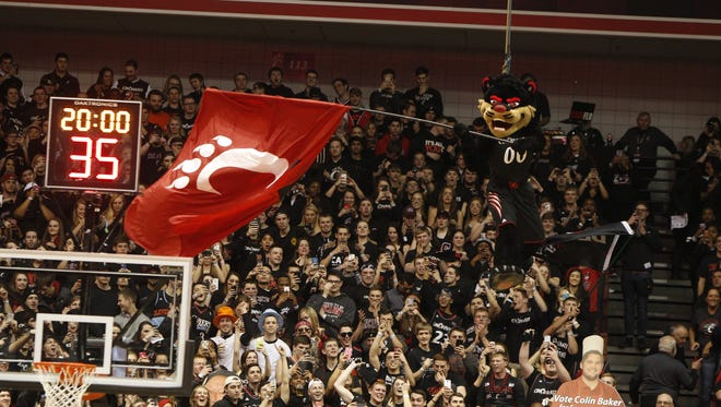 The UC Bearcat is lowered from the ceiling to kick off the Crosstown Shootout at Fifth Third Arena.