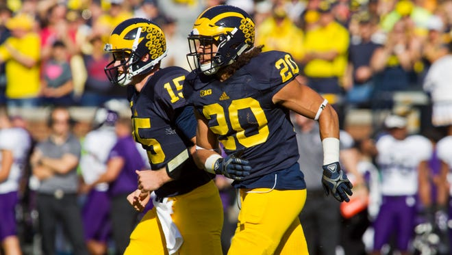 Michigan quarterback Jake Rudock (15) and running back Drake Johnson (20) continue their rise up the 1-128 Re-rank.