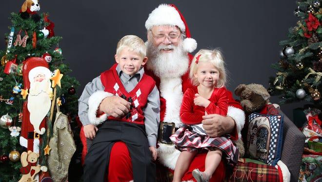 Scott and Charlotte Rough during a Santa photo shoot at the Arizona Republic in Phoenix, AZ on Sunday, November 22, 2015.