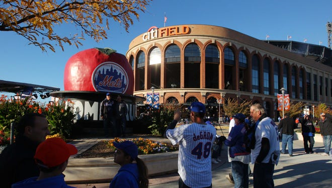 A general view as fans take pictures in front of the apple at Citi Field before Game 3 of the World Series in 2015.