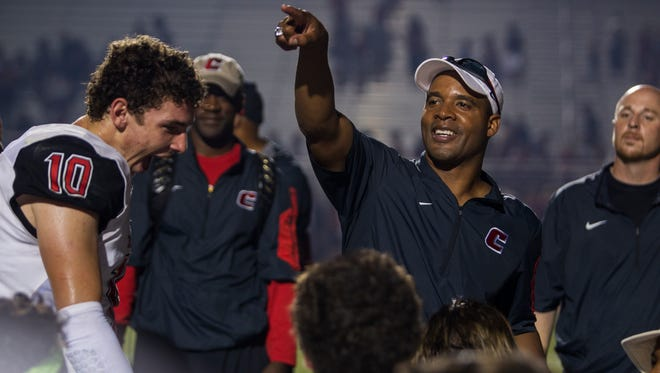 Former Chaparral head coach Conrad Hamilton celebrates with his team after a 2015 game.