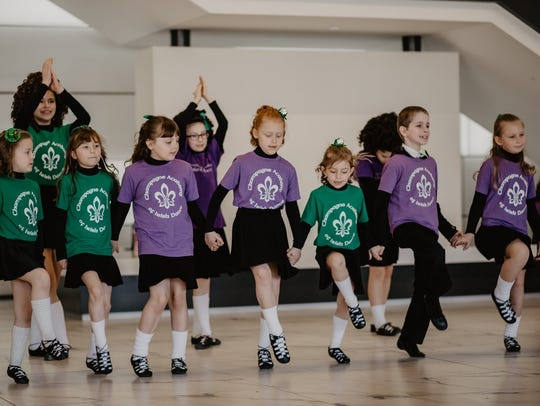 Students of various ages take Irish dancing lessons