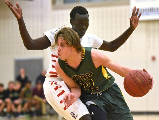 Tyler Kranz of Sauk Rapids-Rice drives past Matt Thuok
