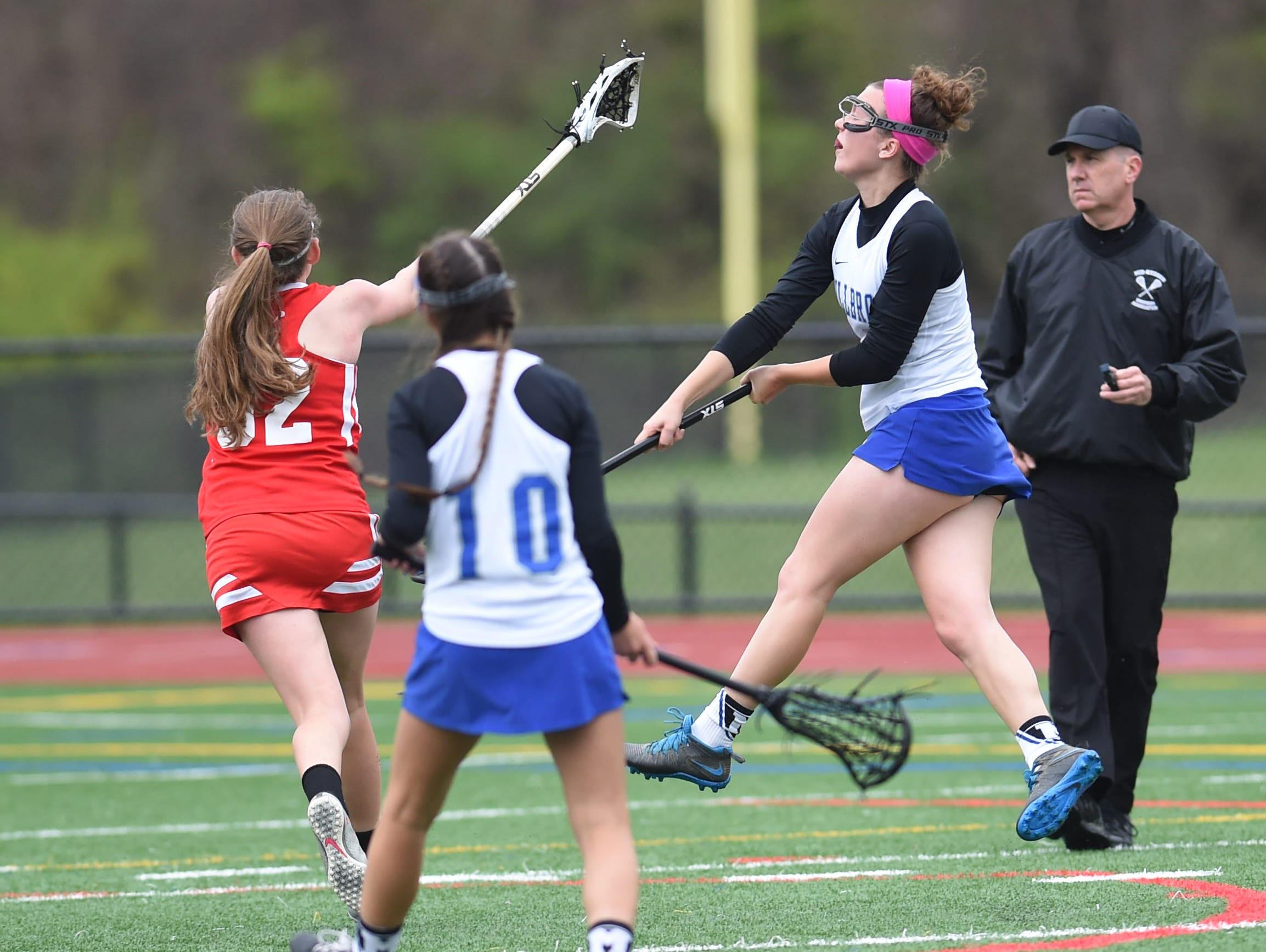 Millbrook's Liz Halpin shoots past Red Hook's Erin Hare to score her first goal during Friday's home game. Halpin went on to score a second goal, the team's fourth which won the game.