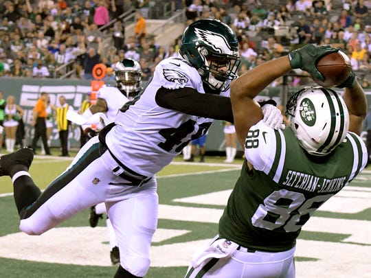 New York Jets tight end Austin Seferian-Jenkins (88) catches a touchdown pass from quarterback Christian Hackenberg as Philadelphia Eagles linebacker Don Cherry (48) defends during the first half of an NFL football game, Thursday, Aug. 31, 2017, in East Rutherford, N.J. (AP Photo/Bill Kostroun)