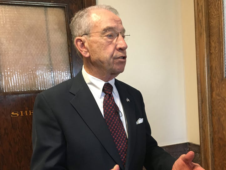 U.S. Sen. Chuck Grassley answers reporters' questions