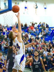 Waynesboro's Cameron Keck puts up a shot against Shippensburg during a boys basketball game on Tuesday, Jan. 3, 2017. The Indians won, 60-56.