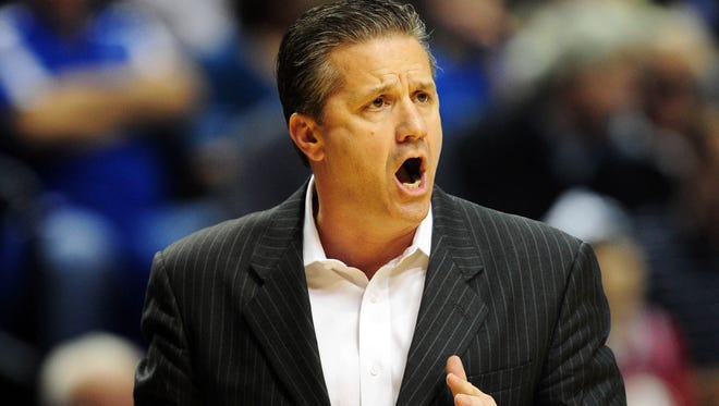 Kentucky Wildcats head coach John Calipari watches his team play against the Vanderbilt Commodores during the quarterfinals of the SEC tournament at Bridgestone Arena. The Commodores beat the Wildcats 64-48.