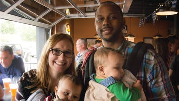 Grace and Keith Elliot had pint-sized company at Trolley Tap House for last year's Taste of Trolley in Wilmington.
