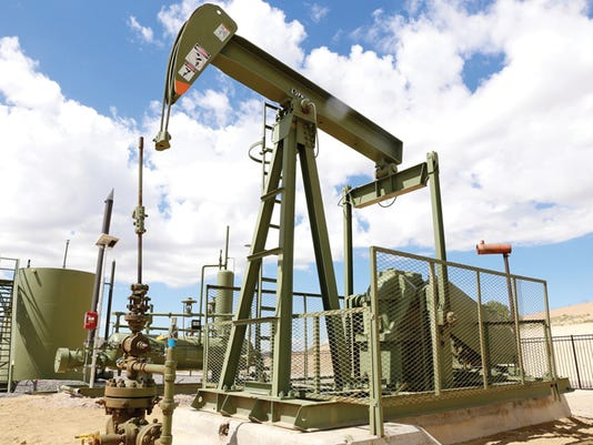 A pump jack is seen with several other pieces of equipment in the new simulated well site area at San Juan College School of Energy in Farmington on July 10.