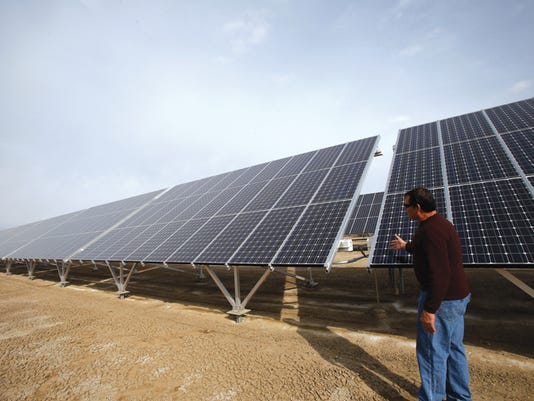 Operations Manager Mike Talovich talks on March 13 about his company's solar panels at Hydropure Technology Inc. in Aztec.