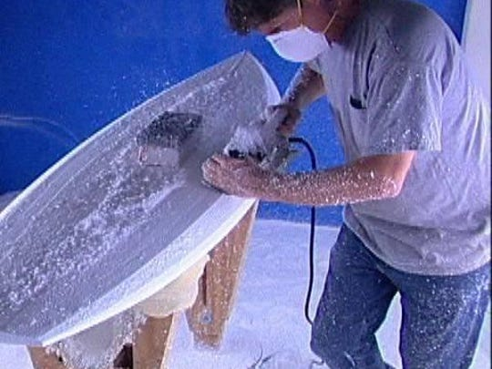 """Greg Loehr, in the shaping room back in the late 1980s, was one of the first to experiment with epoxy resin materials used in the construction of surfboards. Today, more than 50 percent of all surfboards are built with this technology. Loehr is the owner of """"Resin Research"""" with a distribution center in Indian Harbour Beach and headquarters in Tuscon, Arizona."""