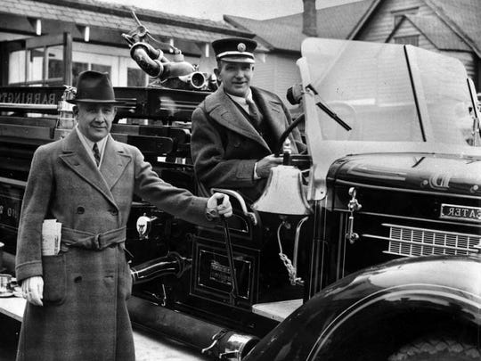 Barrington Mayor Patrick Courtney stands by fire chief Albert Fisher with the town's new fire engine in this February 27, 1937 file photo.