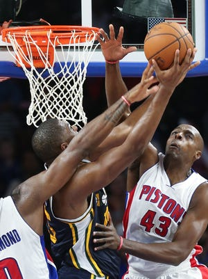 Pistons forward Anthony Tolliver and center Andre Drummond defend against Jazz forward  Derrick Favors during the third period Wednesday at the Palace.