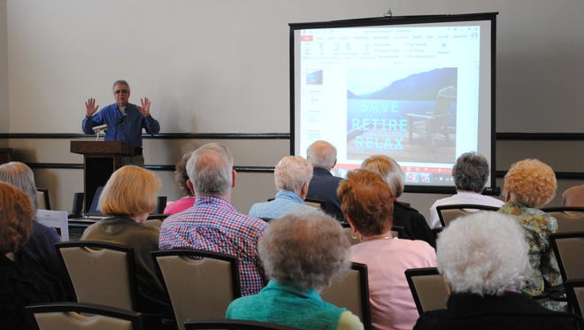 Wayne Police Capt. Laurence Martin explains to seniors at Siena Village how emergency calls are routed in the township.
