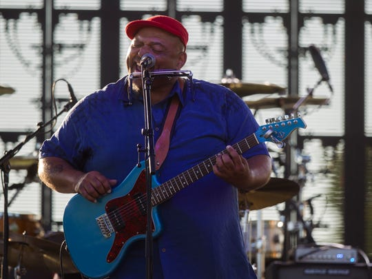 "Kevin ""B.F"" Burt performs in S.T. Morrison Park in"