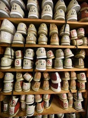 Shoes fill shelves at the Fredericksburg Bowling Center recently. The bowling alley has been a fixture in downtown Fredericksburg since the 1940s.