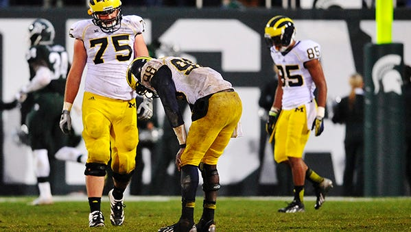 Devin Gardner reacts to a fourth-quarter interception in last year's game against Michigan State.