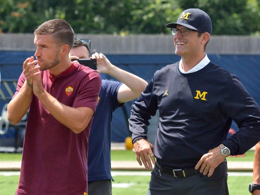 AS Roma midfielder Kevin Strootman and Michigan coach