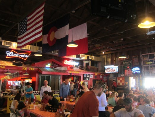 Rudy's cavernous restaurants bring the feel of an outdoor Texas roadside barbecue stand indoors.