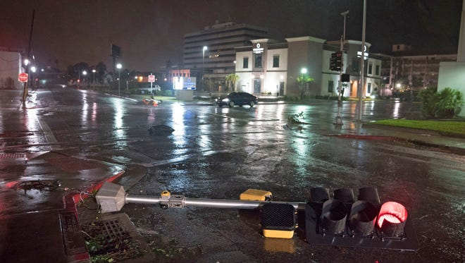 A traffic signal felled by the high winds of Hurricane Harvey lies on a street in Corpus Christi.