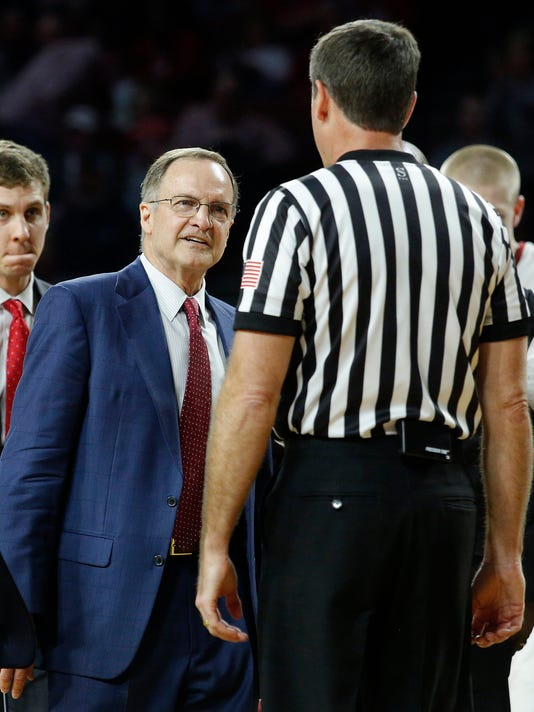 Oklahoma head coach Lon Kruger confronts an official during the first half of an NCAA college basketball game against Kansas State in Norman, Okla., Saturday, Feb. 24, 2018. (AP Photo/Garett Fisbeck)