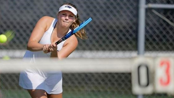 Elise Curtin of Xavier competes in the Bay Conference girls tennis meet Saturday in Appleton.