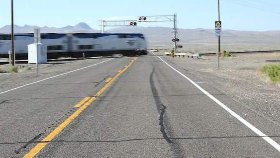 A skid mark leads to the train crossing as the afternoon Amtrak train races across U.S. 95 on Thursday. A year ago, a northbound truck slammed into an Amtrak train at this crossing, killing five on board and the truck driver.