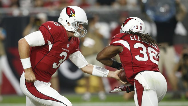 Arizona Cardinals quarterback Carson Palmer, #3, hands off to running back Andre Ellington, #38, during a preseason NFL game against the Kansas City Chiefs at University of Phoenix Stadium in Glendale on Saturday, August 15, 2015.