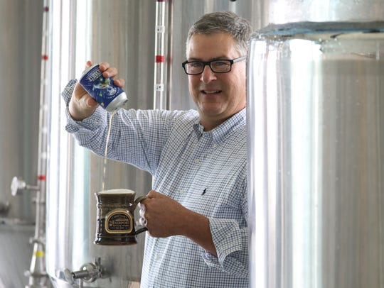Tim Garman, owner of Fairport Brewing in the brewing